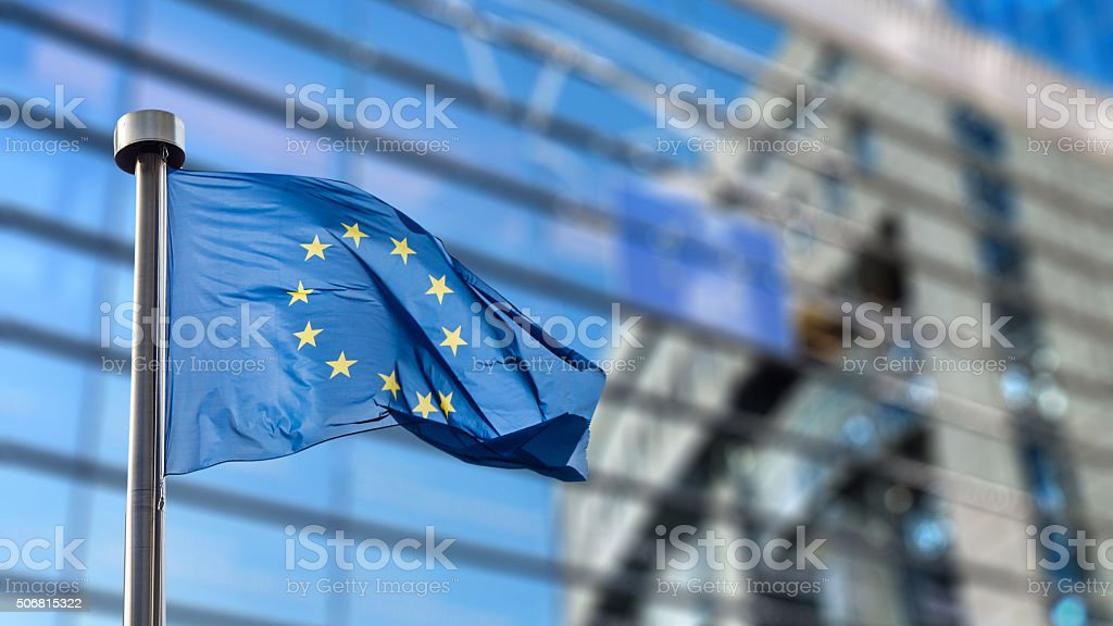 European Union flag against European Parliament royalty-free stock photo