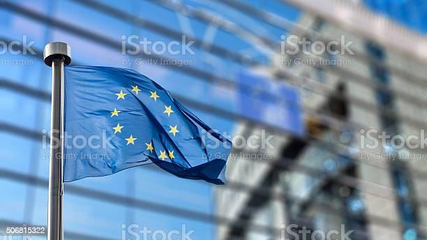 European Union Flag Against European Parliament Stock Photo - Download Image Now