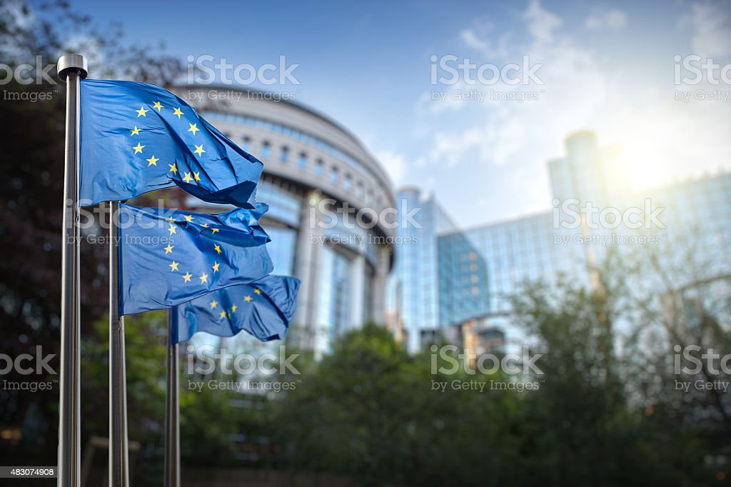 European union flag against parliament in Brussels royalty-free stock photo