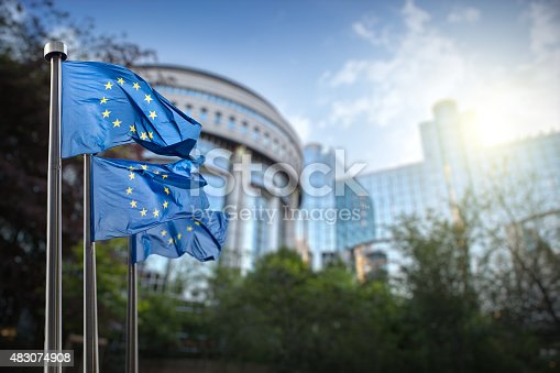 istock European union flag against parliament in Brussels 483074908