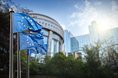 istock European union flag against parliament in Brussels 483074908