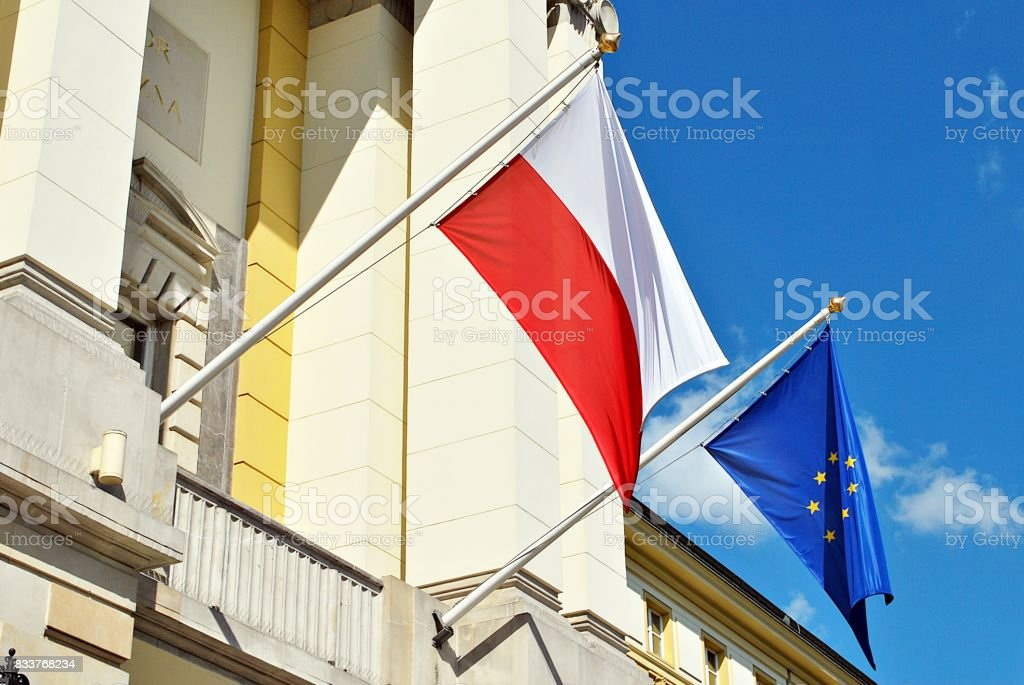 European Union flag and a Polish flag. stock photo