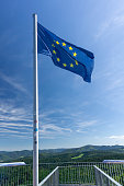 European Union flag sited on the tower of Urenkopf and the view of the Black Forest, Haslach im Kinzigtal, Baden-Württemberg, Germany.