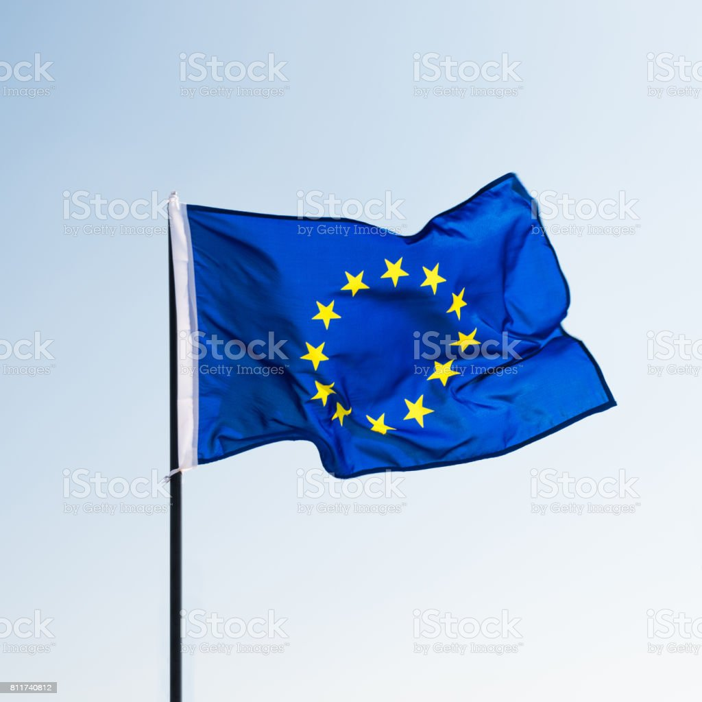 European union flag waving in the wind stock photo