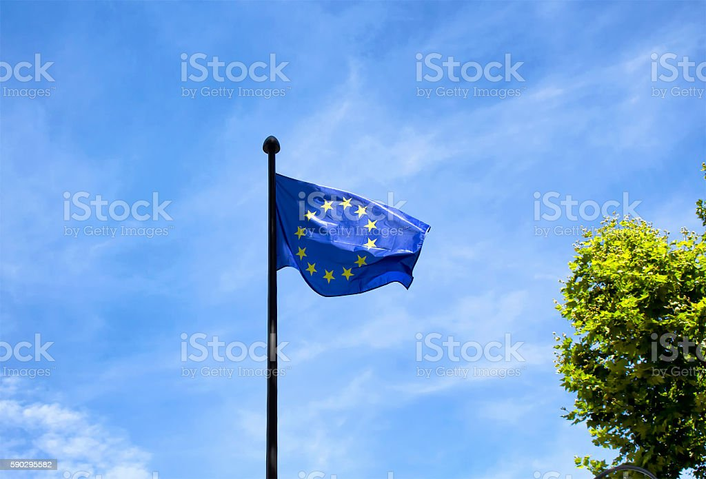 European Union flag with blue sky background in Paris stock photo