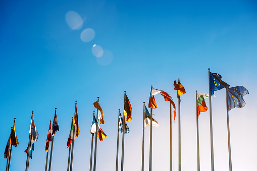 European Union Flags Against Blue Sky Stock Photo - Download Image Now
