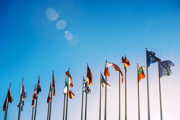 European Union flags against blue sky stock photo
