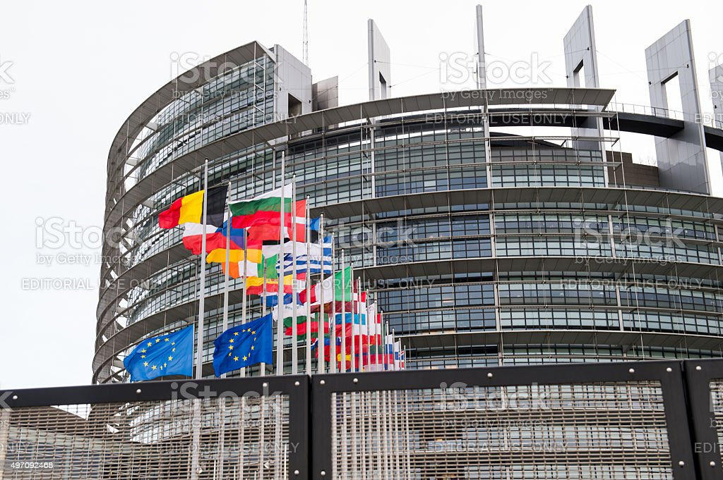 European Union Flags and France flag flies at half-mast stock photo
