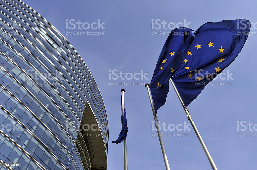 European Union flags fluttering in breeze stock photo