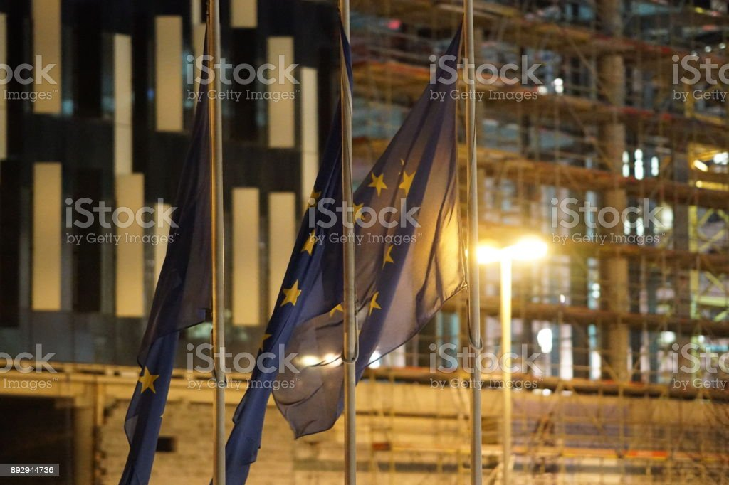 European Union flags fluttering stock photo