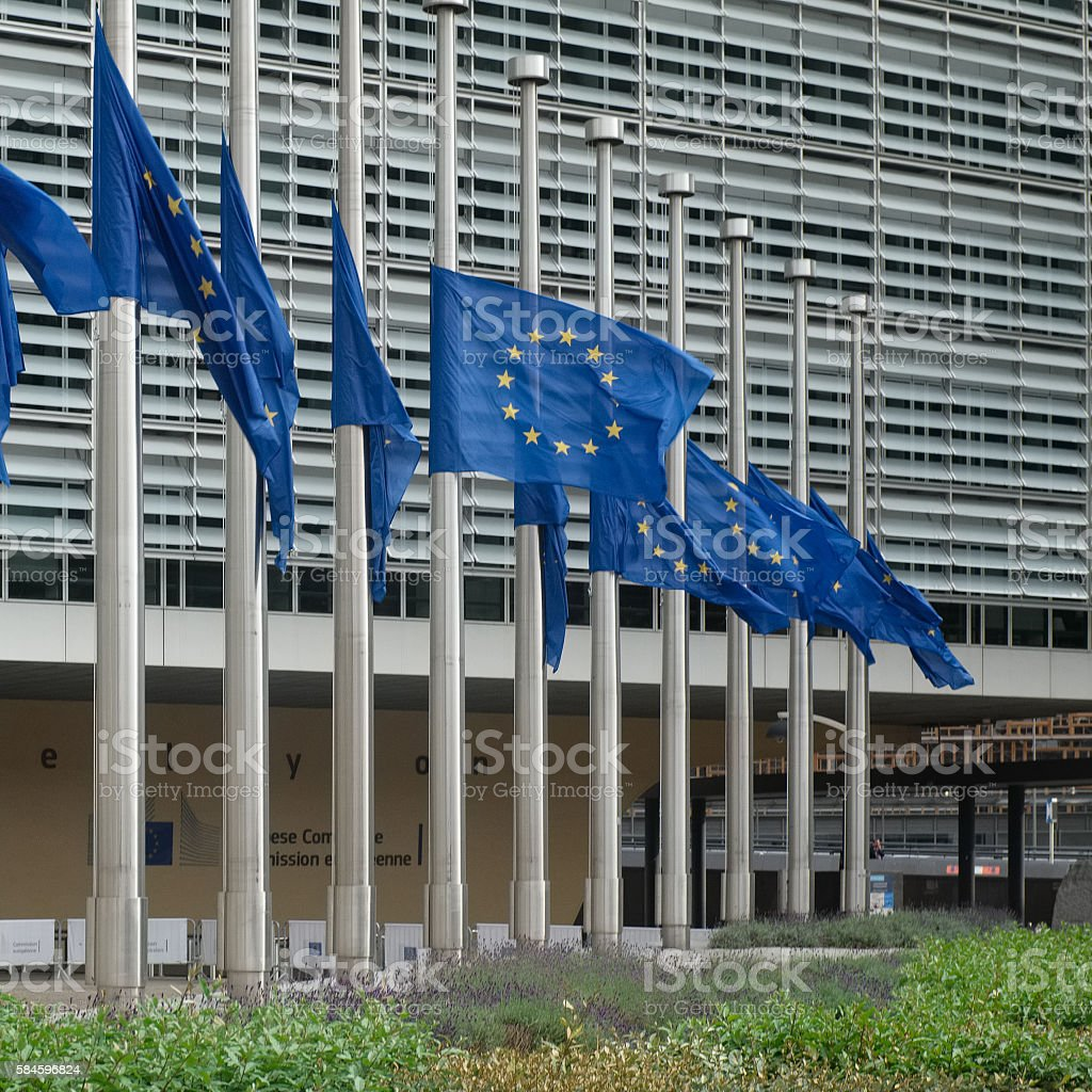 European Union flags half mast at Commission building in Brussels stock photo