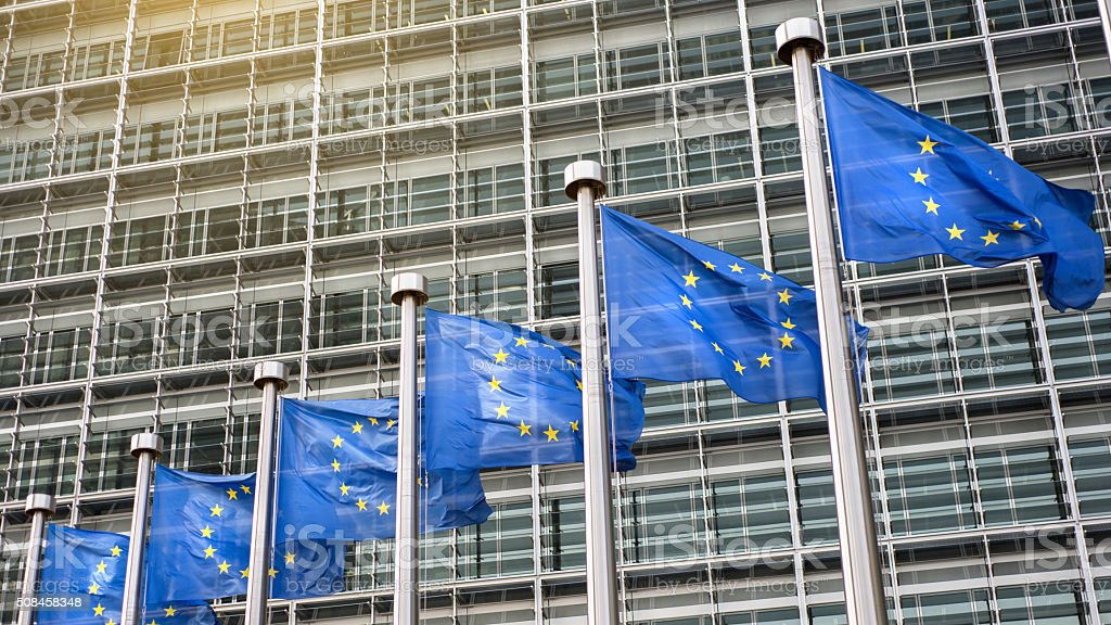 European Union flags in front of the Berlaymont stock photo