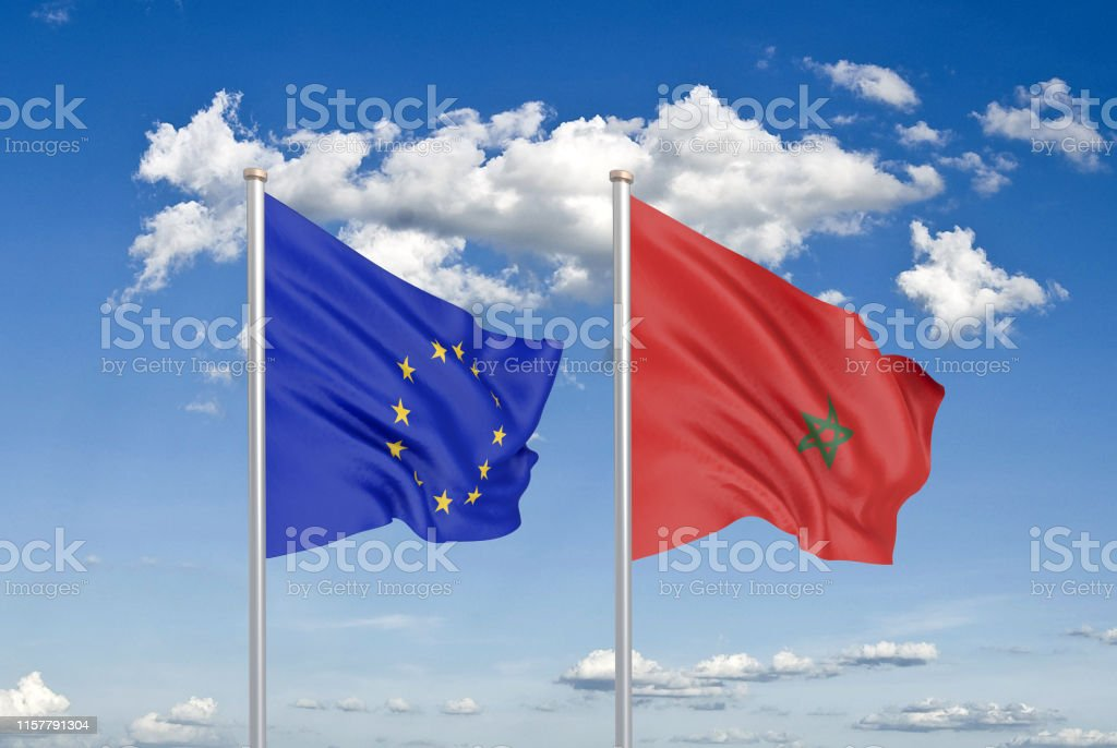 European Union vs Morocco. Thick colored silky flags of European...