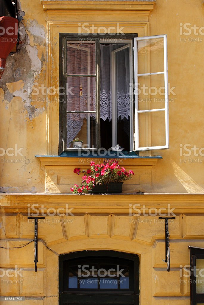 European window with colorful flowerbox royalty-free stock photo