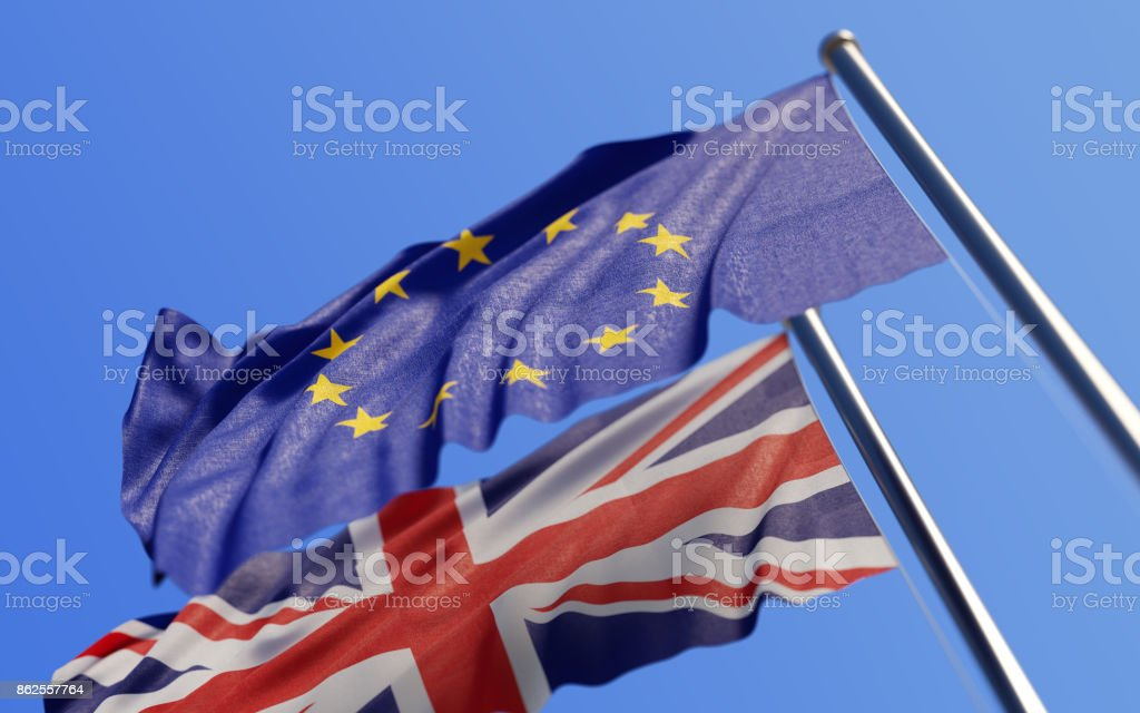 Europen Union And British Flags Waving With Wind On Blue Sky - foto stock