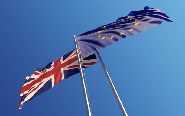Europen Union and United Kingdom Flags Waving With Wind: Dispute Concept stock photo