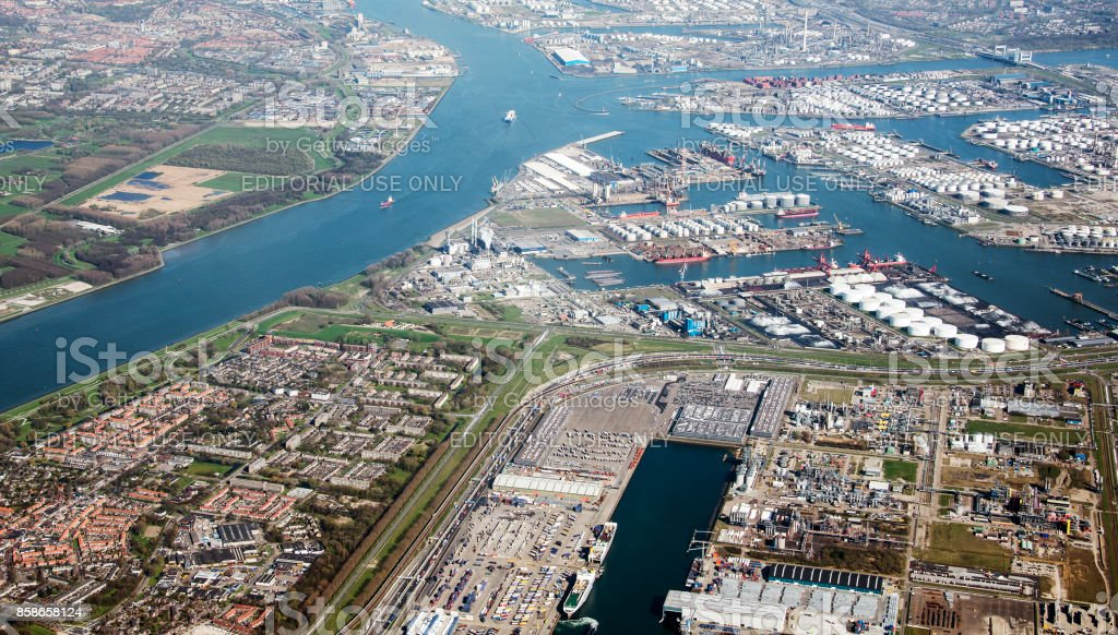europoort rotterdam from the sky with rozenburg village stock photo