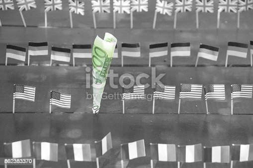 istock Euros and flags of the world 862383370