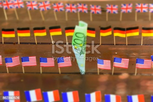 istock Euros and flags of the world 862392526