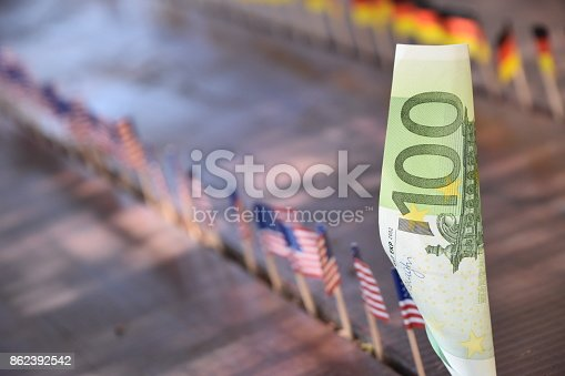 istock Euros and flags of the world 862392542