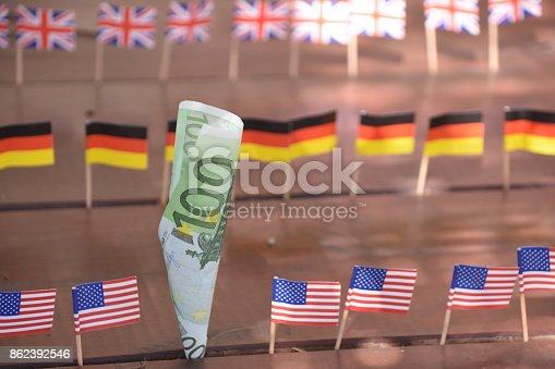 istock Euros and flags of the world 862392546