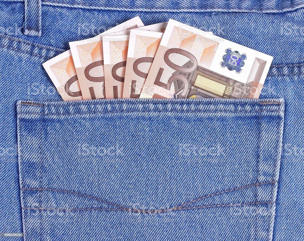 50 Euros bills in blue jeans pocket. stock photo