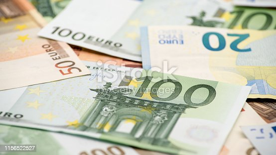 Euros bills of different values. A euro bill of one hundred. Cash money background. Real banknotes hundred. Good earnings. Issuing the salary. Credit percent