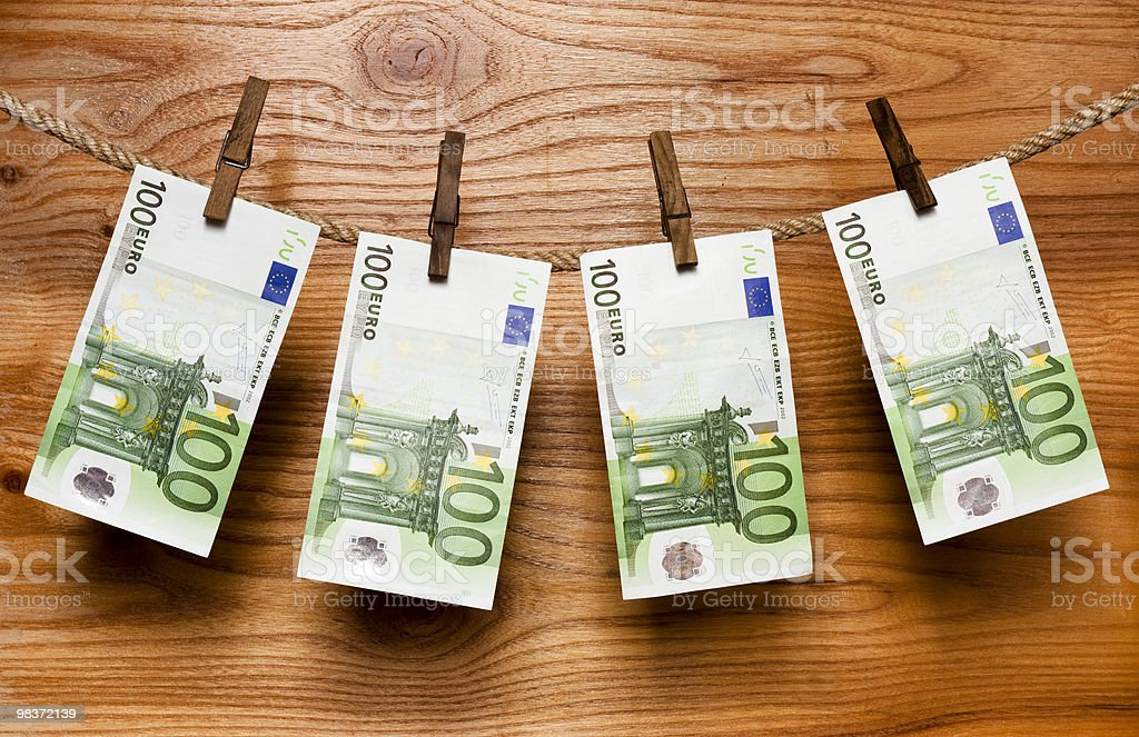 Euros hang on  old clothes-peg royalty-free stock photo