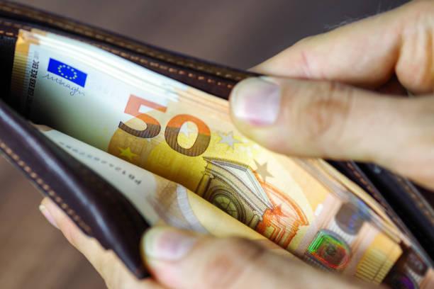 Euros in wallet stock photo