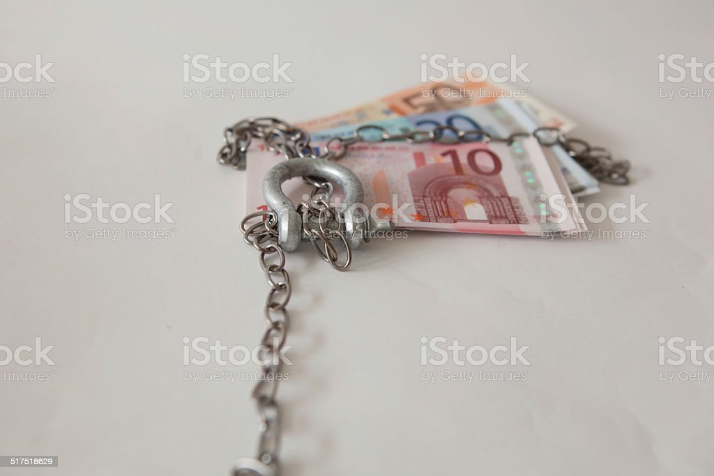 euros large lock bolt tied up silver chain stock photo