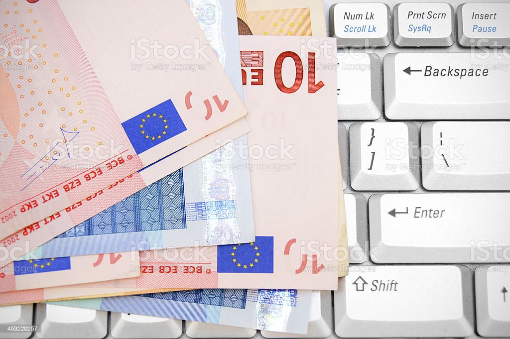 Euros on the keyboard. royalty-free stock photo