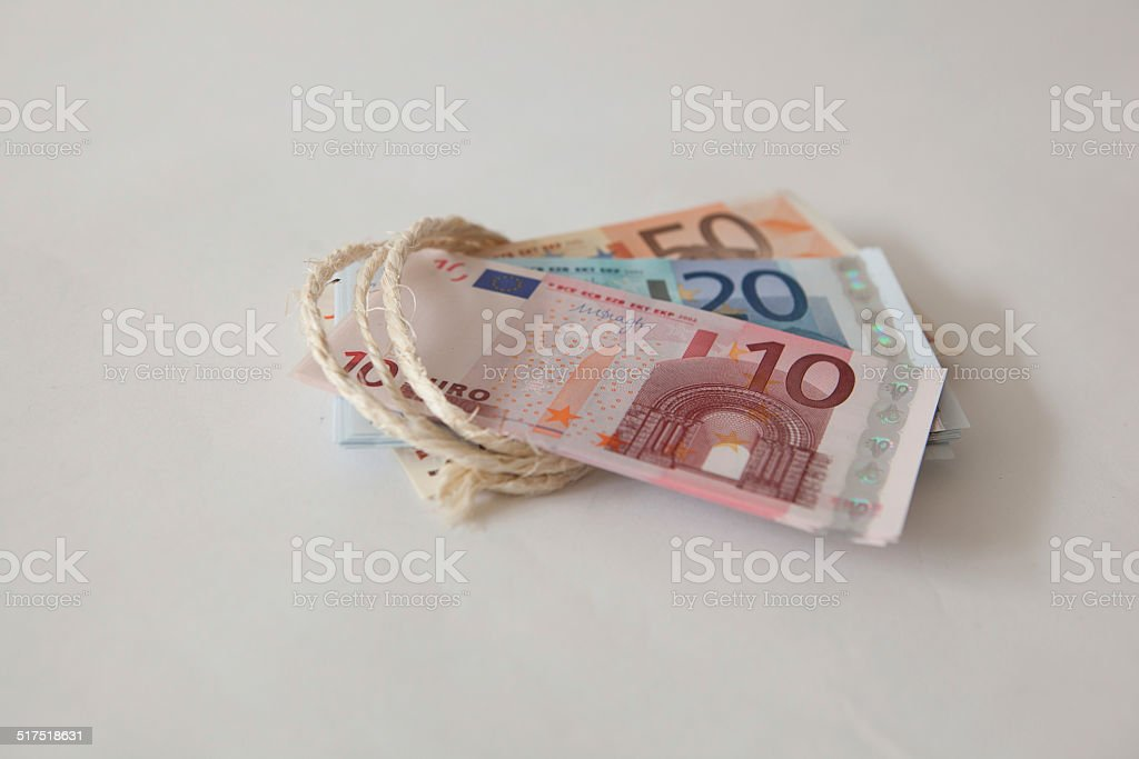 euros tied up with string stock photo