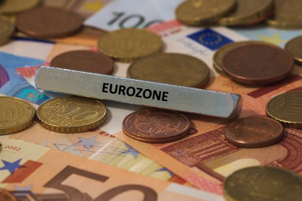 eurozone - the word was printed on a metal bar. the metal bar was placed on several banknotes stock photo
