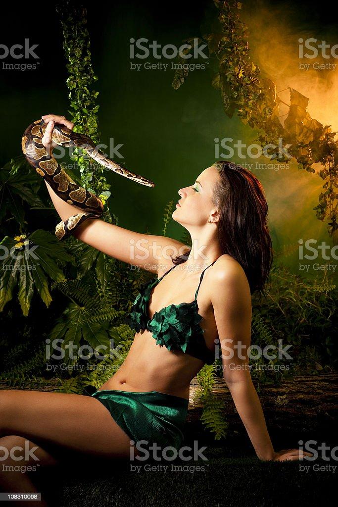 Eva and Snake stock photo