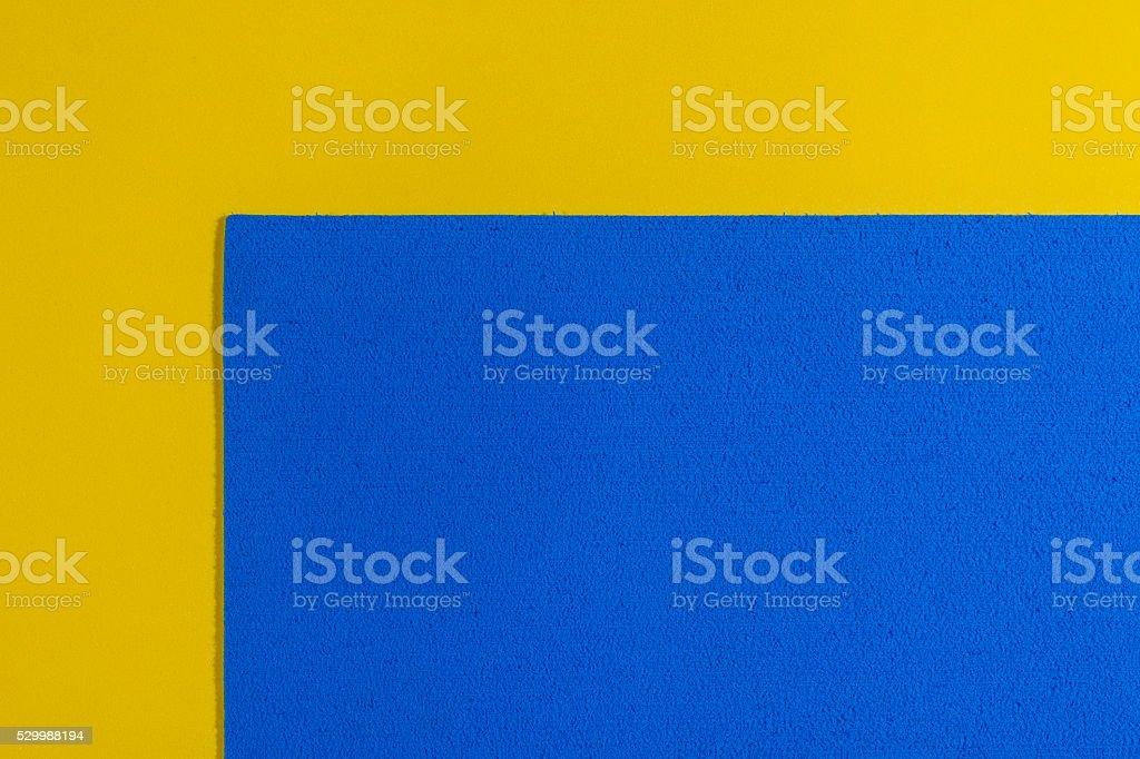 Eva foam blue on smooth lemon yellow stock photo