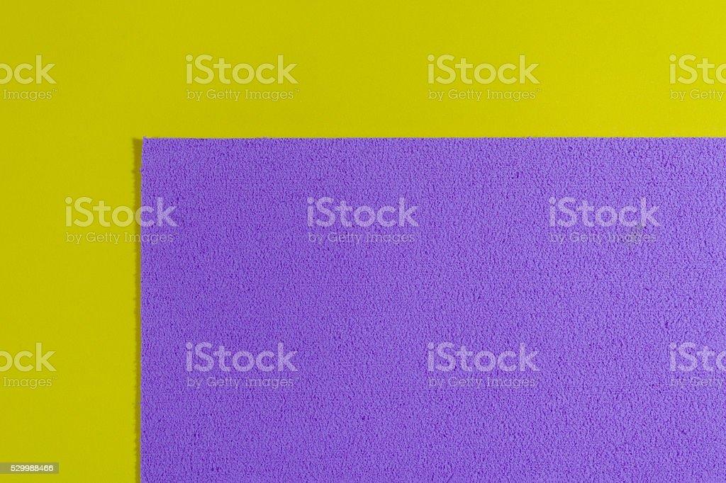 Eva foam light purple on smooth lemon yellow stock photo