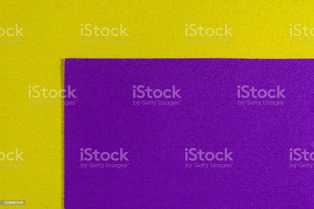 Eva foam purple on lemon yellow stock photo