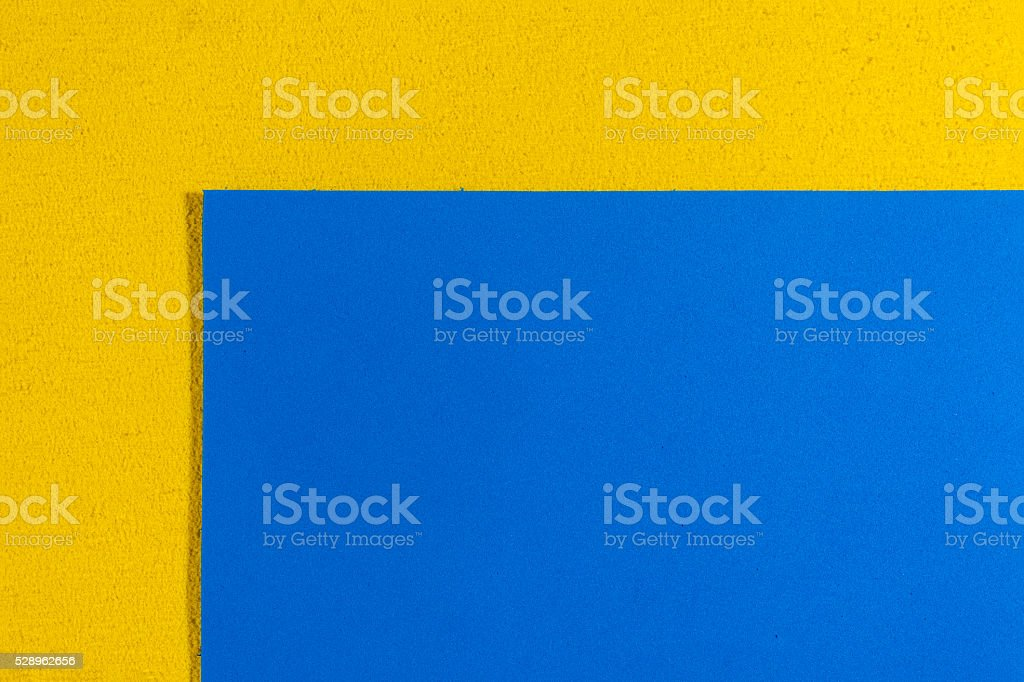 Eva foam smooth blue on lemon yellow stock photo