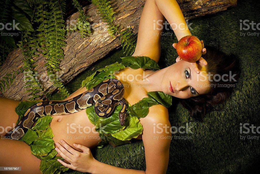 Eva, Snake and red Apple in the Garden of Eden.