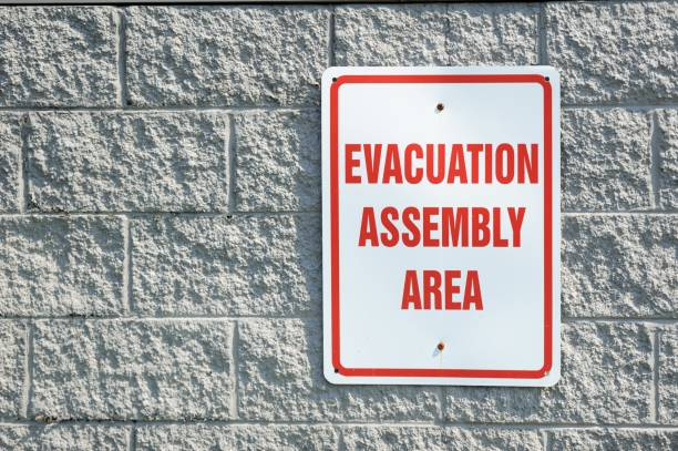 Evacuation assembly area sign stock photo