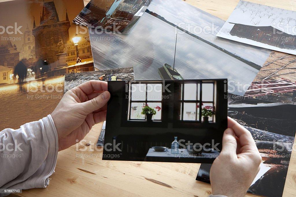 Evaluating photographs royalty-free stock photo