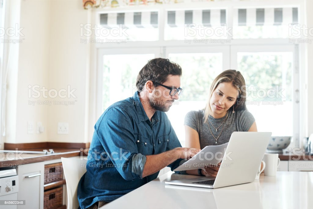 Evaluating their income and expenditure stock photo