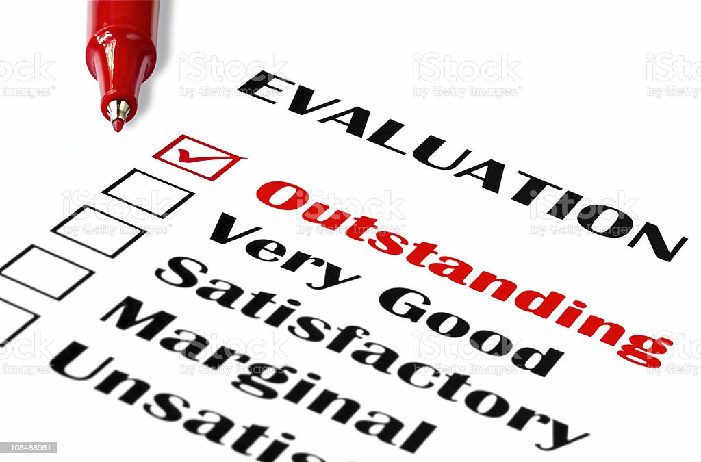 Evaluation form with a red pen tick in outstanding royalty-free stock photo