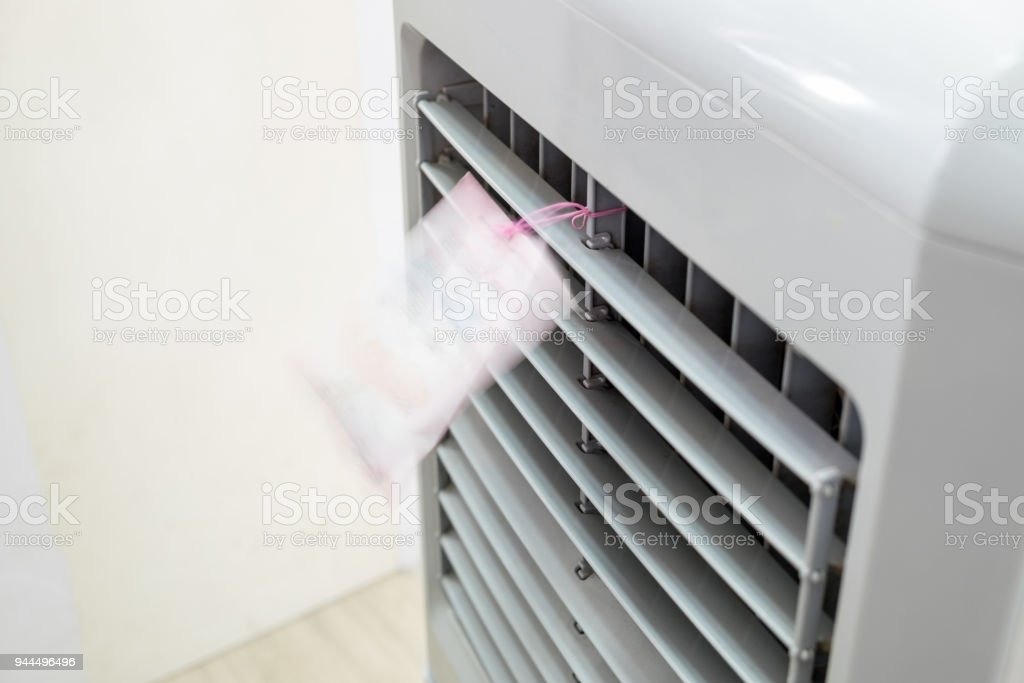 Evaporative air cooler front running blown stock photo