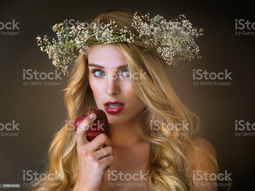 Eve and that fateful apple stock photo