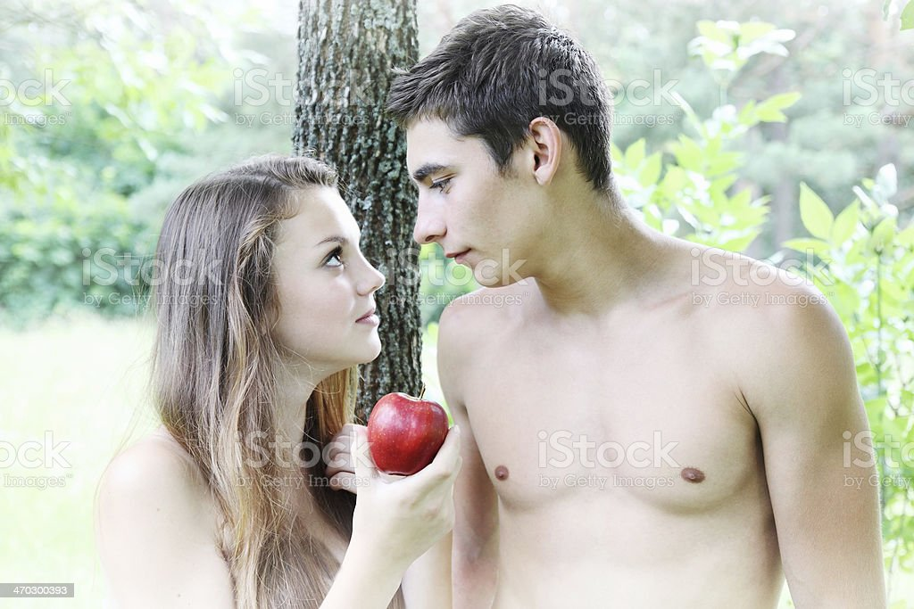 Eve holding an apple stock photo