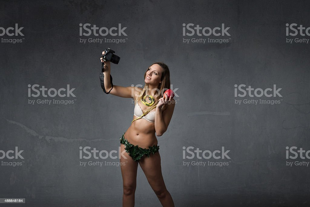 eve taking selfie with reflex stock photo