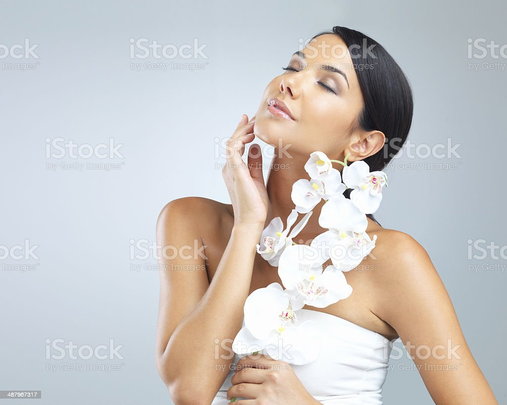 Even a beautiful orchid is made ordinary next to her stock photo