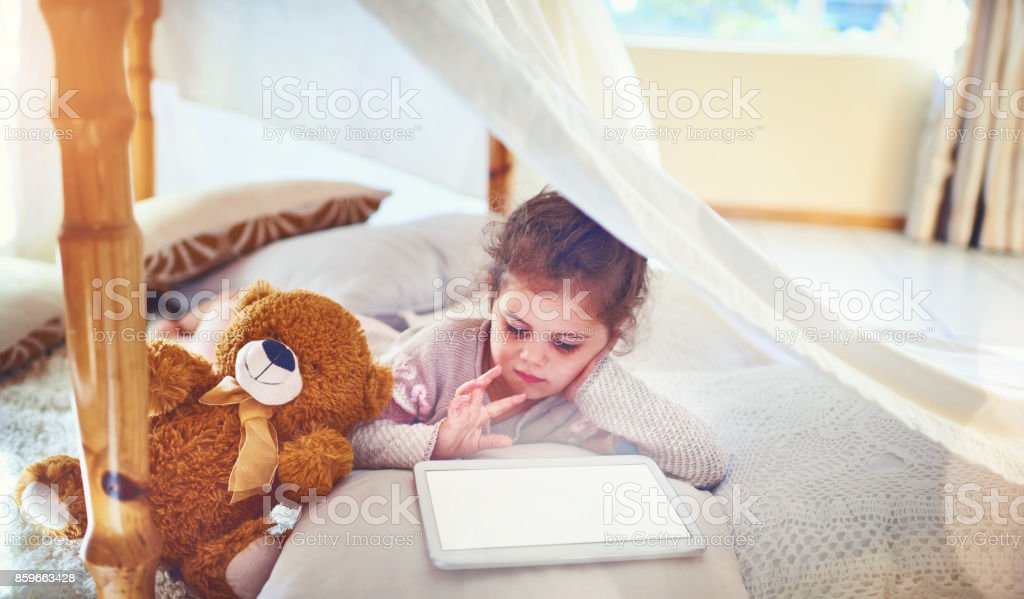 Even little kids these days know so much about technology stock photo
