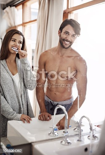 874030164 istock photo Even teeth brushing can be a bonding exercise 1055064362